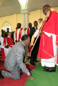 President Sata kissing the feet of Jesus